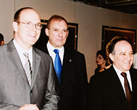 "With Alberto II, Prince of Monaco during the exhibition ""Nine Cuban Painters,"" at the Antonio I Hall, Monaco Principality."